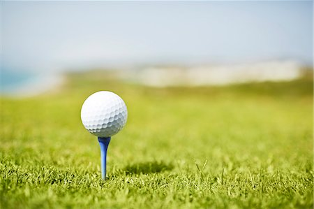 Golf ball on tee Stock Photo - Premium Royalty-Free, Code: 6113-07159332