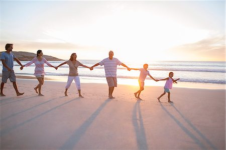 preteen beach - Family holding hands on beach Stock Photo - Premium Royalty-Free, Code: 6113-07159488