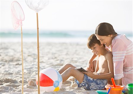 Mother and son relaxing on beach Stock Photo - Premium Royalty-Free, Code: 6113-07159489