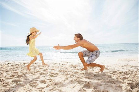 families playing on the beach - Father and daughter playing on beach Stock Photo - Premium Royalty-Free, Code: 6113-07159492