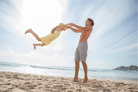 Father and daughter playing on beach Stock Photo - Premium Royalty-Free, Code: 6113-07159496