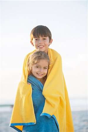 sister - Brother and sister wrapped in towels on beach Stock Photo - Premium Royalty-Free, Code: 6113-07159498