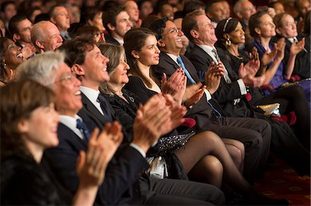 Clapping theater audience Stock Photo - Premium Royalty-Free, Code: 6113-07159402