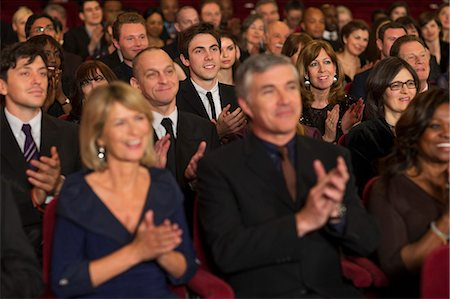 Clapping theater audience Stock Photo - Premium Royalty-Free, Code: 6113-07159407