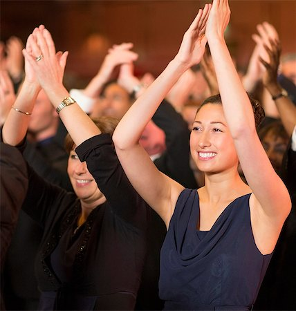 filipino - Enthusiastic women clapping in theater audience Stock Photo - Premium Royalty-Free, Code: 6113-07159408