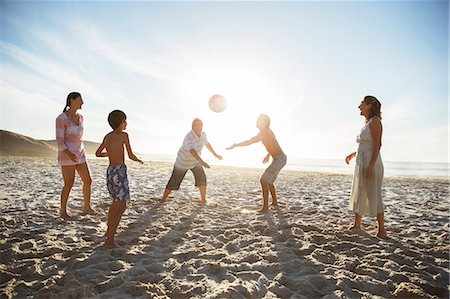 preteen beach - Multi-generation family playing volleyball on beach Stock Photo - Premium Royalty-Free, Code: 6113-07159541
