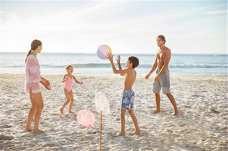 preteen girl topless - Family playing on beach Stock Photo - Premium Royalty-Free, Code: 6113-07159544