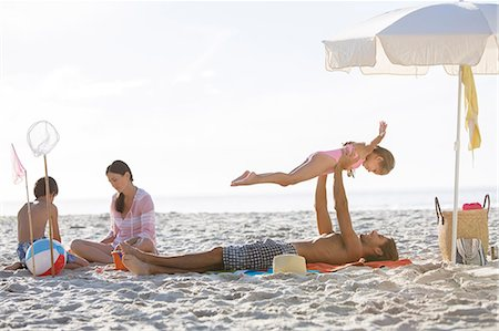 pre-teen beach - Family relaxing together on beach Stock Photo - Premium Royalty-Free, Code: 6113-07159550