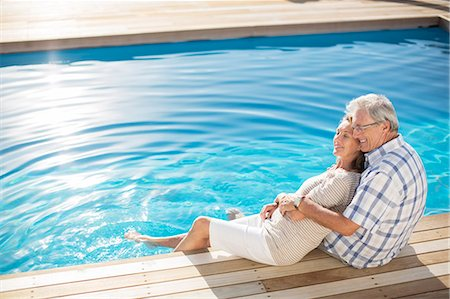Senior couple relaxing by pool Stock Photo - Premium Royalty-Free, Code: 6113-07159551