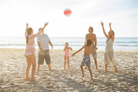 preteen girl topless - Family playing together on beach Stock Photo - Premium Royalty-Free, Code: 6113-07159554