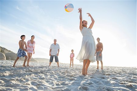 Family playing together on beach Stock Photo - Premium Royalty-Free, Code: 6113-07159559