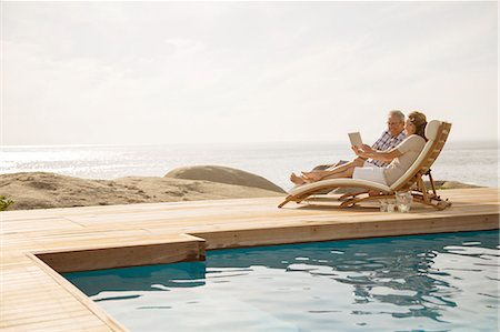 pool - Older couple relaxing by pool Stock Photo - Premium Royalty-Free, Code: 6113-07159560