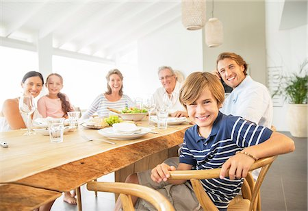 Family smiling together at table Stock Photo - Premium Royalty-Free, Code: 6113-07159566