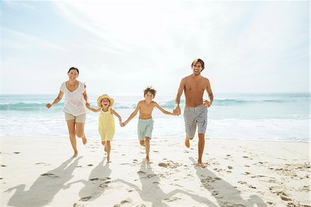 preteen beach - Family running together on beach Stock Photo - Premium Royalty-Free, Code: 6113-07159573