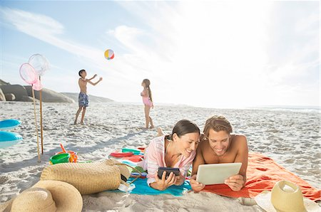 families playing on the beach - Family relaxing together on beach Stock Photo - Premium Royalty-Free, Code: 6113-07159577