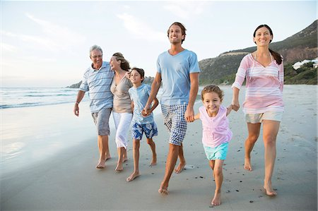 preteen beach - Family walking together on beach Stock Photo - Premium Royalty-Free, Code: 6113-07159579