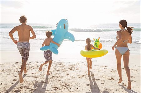Family playing together on beach Stock Photo - Premium Royalty-Free, Code: 6113-07159592