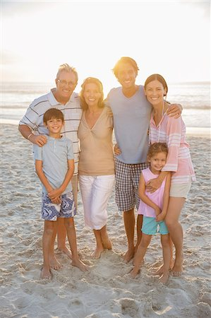 preteen beach - Family smiling together on beach Stock Photo - Premium Royalty-Free, Code: 6113-07159595