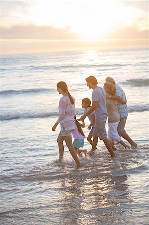 preteen beach - Multi-generation family walking in surf at beach Stock Photo - Premium Royalty-Free, Code: 6113-07159503