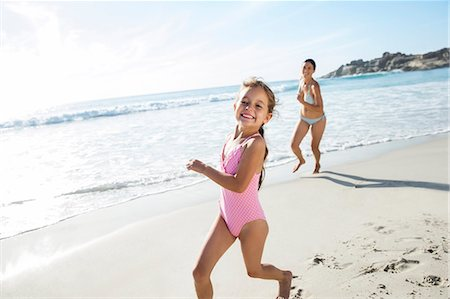 Mother and daughter running on beach Stock Photo - Premium Royalty-Free, Code: 6113-07159501