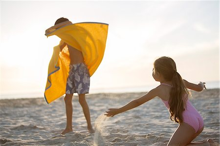 preteen bathing suit - Children playing on beach Stock Photo - Premium Royalty-Free, Code: 6113-07159509