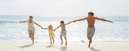 preteen beach - Family running together on beach Stock Photo - Premium Royalty-Free, Code: 6113-07159517