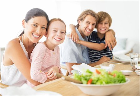 eating - Family sitting together at table Stock Photo - Premium Royalty-Free, Code: 6113-07159514