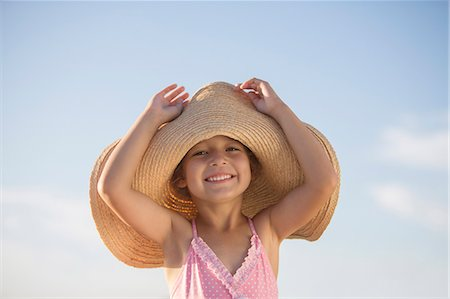 Girl wearing sun hat outdoors Stock Photo - Premium Royalty-Free, Code: 6113-07159521
