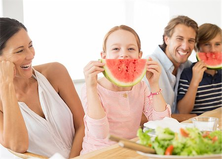 fun - Family eating watermelon at table Stock Photo - Premium Royalty-Free, Code: 6113-07159538