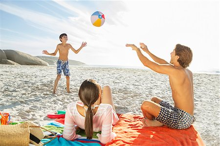 preteen girl topless - Family playing together on beach Stock Photo - Premium Royalty-Free, Code: 6113-07159539