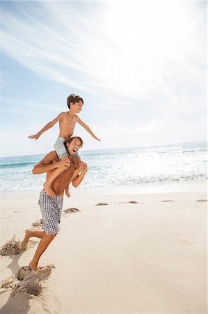 preteen beach - Father and son playing on beach Stock Photo - Premium Royalty-Free, Code: 6113-07159608