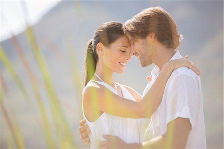 romanticism - Couple hugging outdoors Stock Photo - Premium Royalty-Free, Code: 6113-07159634