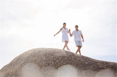 Couple walking on rock formation Stock Photo - Premium Royalty-Free, Code: 6113-07159635