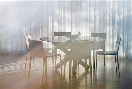 Table and chairs in dining room Stock Photo - Premium Royalty-Free, Code: 6113-07159760