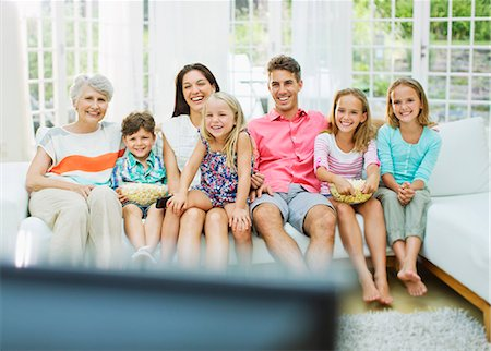 entertainment - Family watching television together Stock Photo - Premium Royalty-Free, Code: 6113-07159701