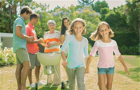 Family relaxing together in backyard Stock Photo - Premium Royalty-Free, Code: 6113-07159704