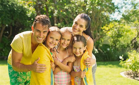 Family relaxing together in backyard Stock Photo - Premium Royalty-Free, Code: 6113-07159708