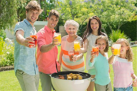 Family barbecuing together in backyard Stock Photo - Premium Royalty-Free, Code: 6113-07159712