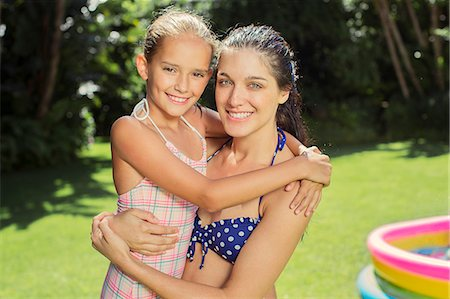 Mother and daughter hugging in backyard Stock Photo - Premium Royalty-Free, Code: 6113-07159716