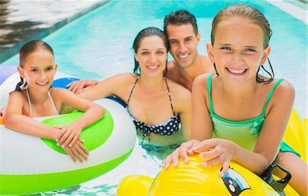 Family swimming together in pool Stock Photo - Premium Royalty-Free, Code: 6113-07159726