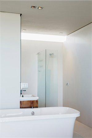 shower - Bathtub, shower and sink in modern bathroom Stock Photo - Premium Royalty-Free, Code: 6113-07159854