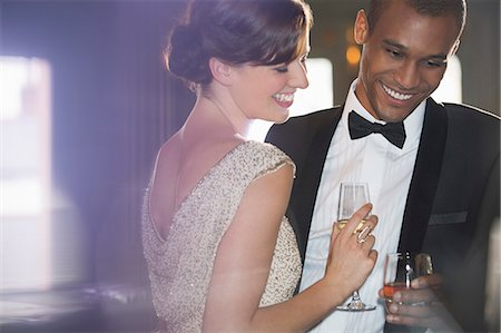 Well dressed couple drinking champagne and cocktail Stock Photo - Premium Royalty-Free, Code: 6113-07159887