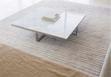 Coffee table in modern living room Stock Photo - Premium Royalty-Free, Code: 6113-07159836