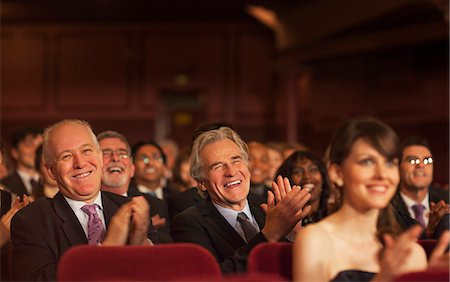 Theater audience laughing and clapping Stock Photo - Premium Royalty-Free, Code: 6113-07159942