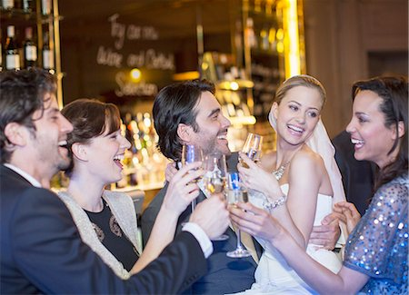 Friends toasting happy bride and groom at wedding reception Stock Photo - Premium Royalty-Free, Code: 6113-07159953
