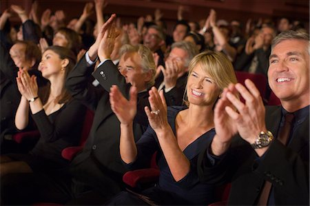 Enthusiastic audience clapping in theater Stock Photo - Premium Royalty-Free, Code: 6113-07159981