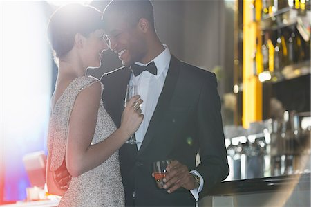 Well dressed couple hugging in luxury bar Stock Photo - Premium Royalty-Free, Code: 6113-07159988