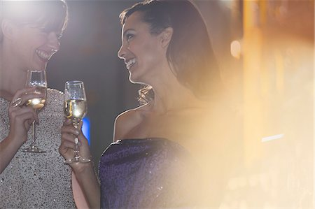 Well dressed women drinking champagne in luxury bar Stock Photo - Premium Royalty-Free, Code: 6113-07159990