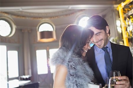 Well dressed couple drinking champagne in luxury bar Stock Photo - Premium Royalty-Free, Code: 6113-07159991