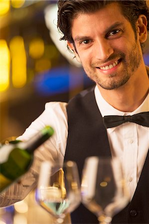 pouring - Close up portrait of well dressed bartender pouring wine Stock Photo - Premium Royalty-Free, Code: 6113-07159915